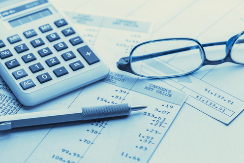 pen_calculator_glasses_financials_dreamstime_extra_small.jpg