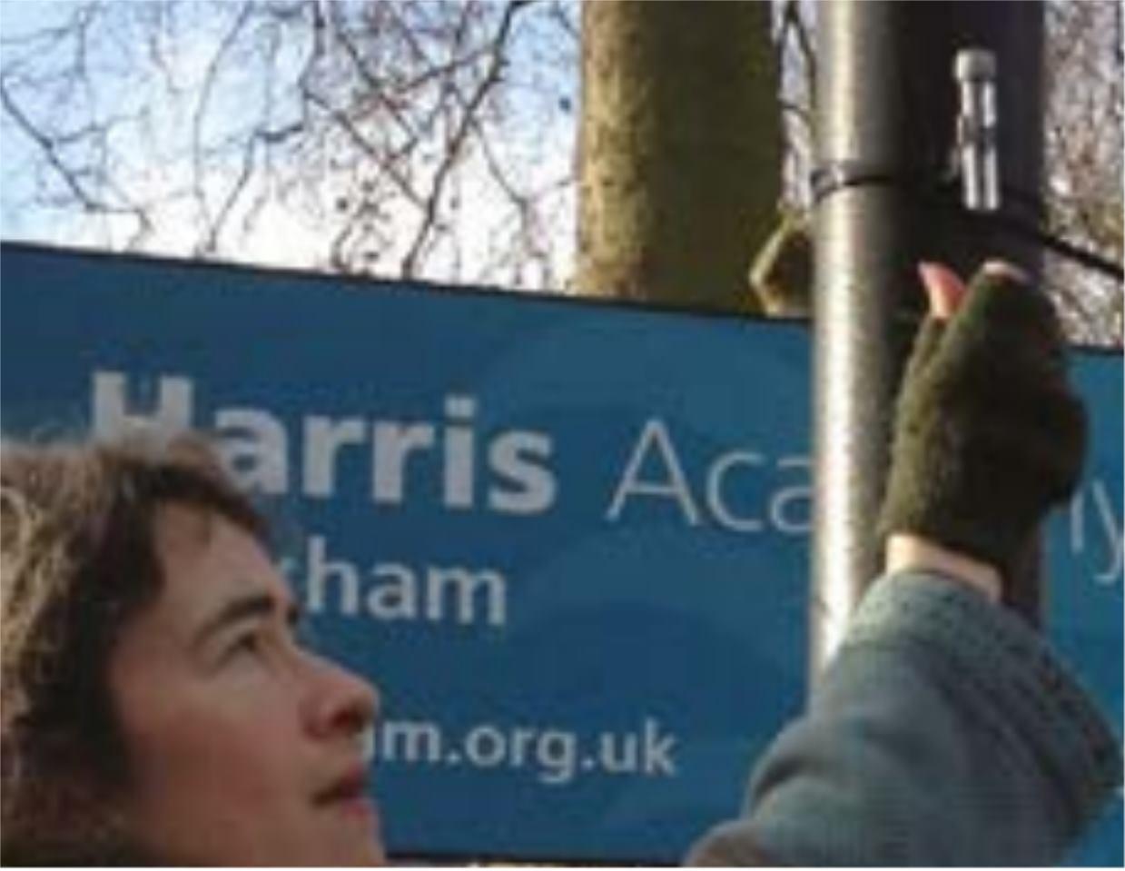 Eleanor Margolies measuring air pollution outside a Peckham school