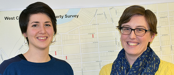 Photo of Katy Zinler and Katy Shedlock in front of map of West Central neighborhood