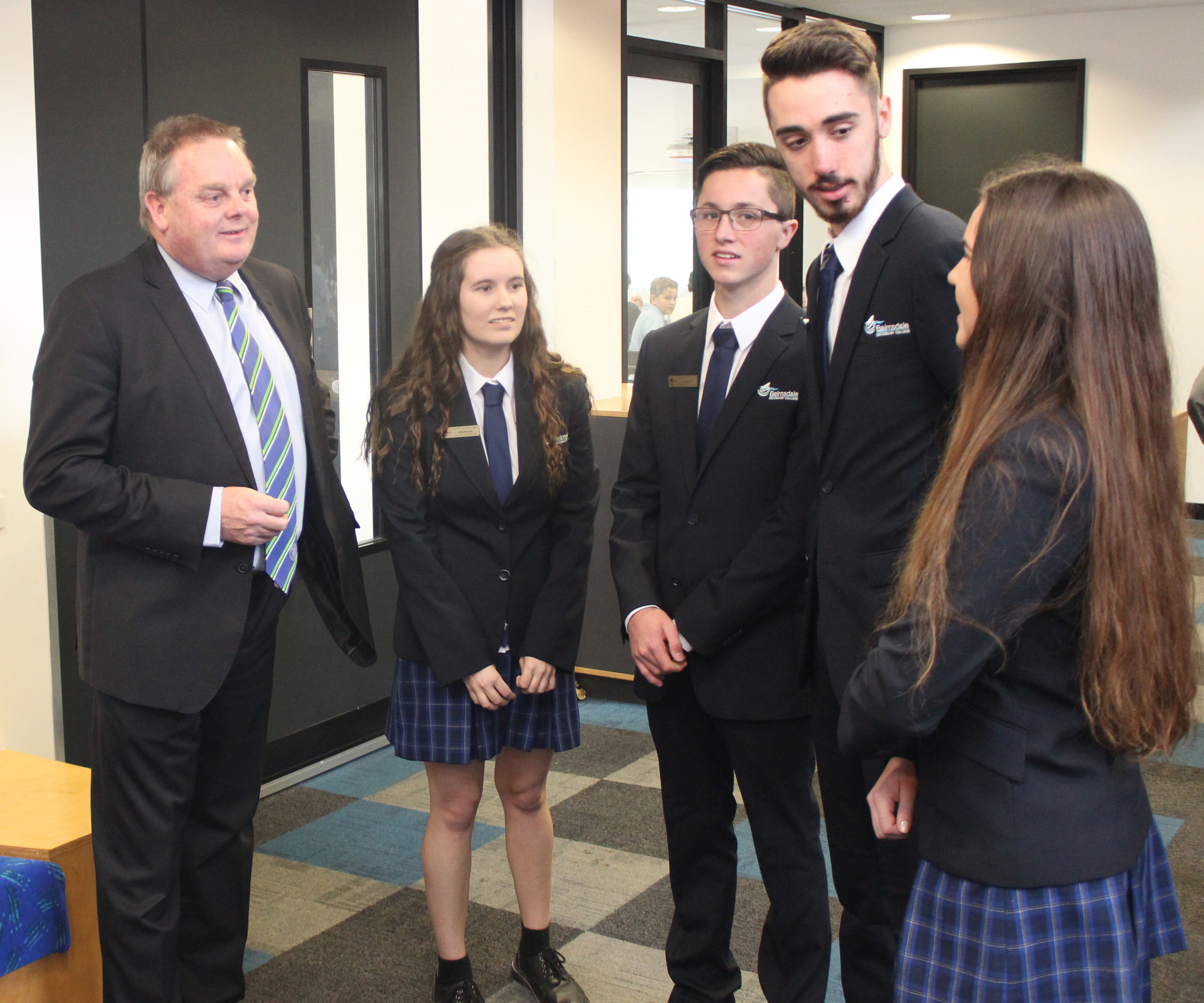 Caption: Gippsland East Nationals MP, Tim Bull, speaking with senior Bairnsdale Secondary College students Anna Wilson, Jacob Ellett, Jarrod Stephens and Zoe Lanigan, has announced a Liberal Nationals Government will create the Rural Tertiary Network to better support students who study away from home at the completion of their schooling.