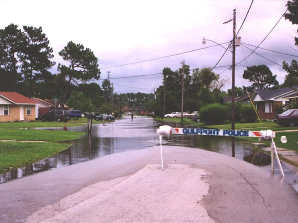 Police barricades block off a flooded street in North Gulfport