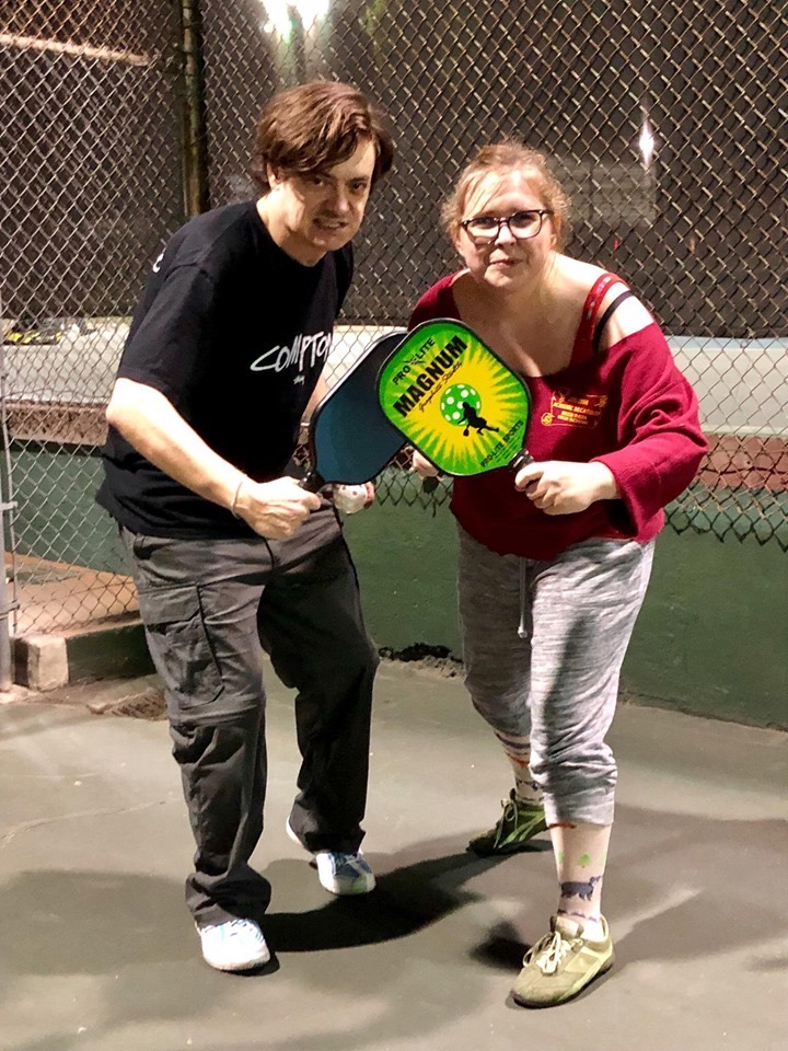 Todd and Chole posing with pickleball paddles