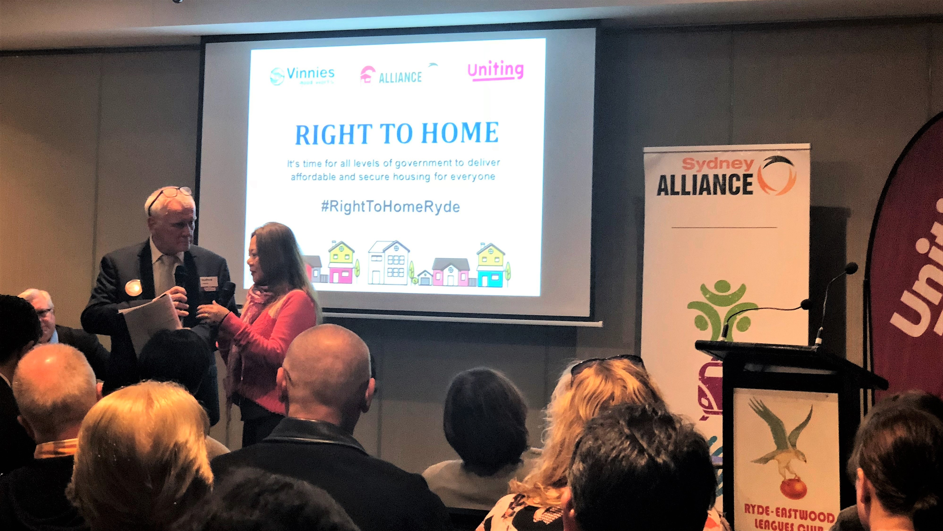 Local renter Tammy Wang shares her experiences with Stafford Sanders of Uniting and the Sydney Alliance at the Ryde forum – and an audience of 150 representing ov er 1000 organisations across Sydney.