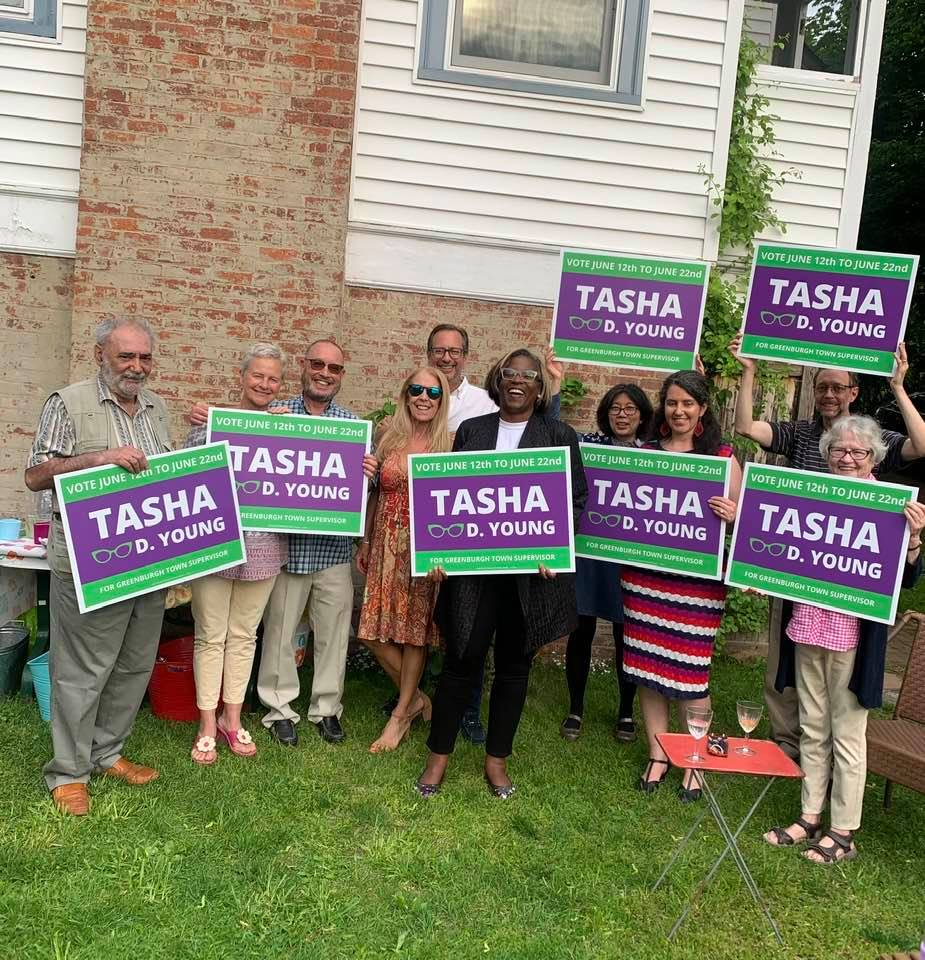 friends of Tasha with signs