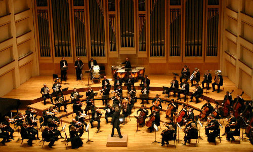 An orchestra playing on a stage