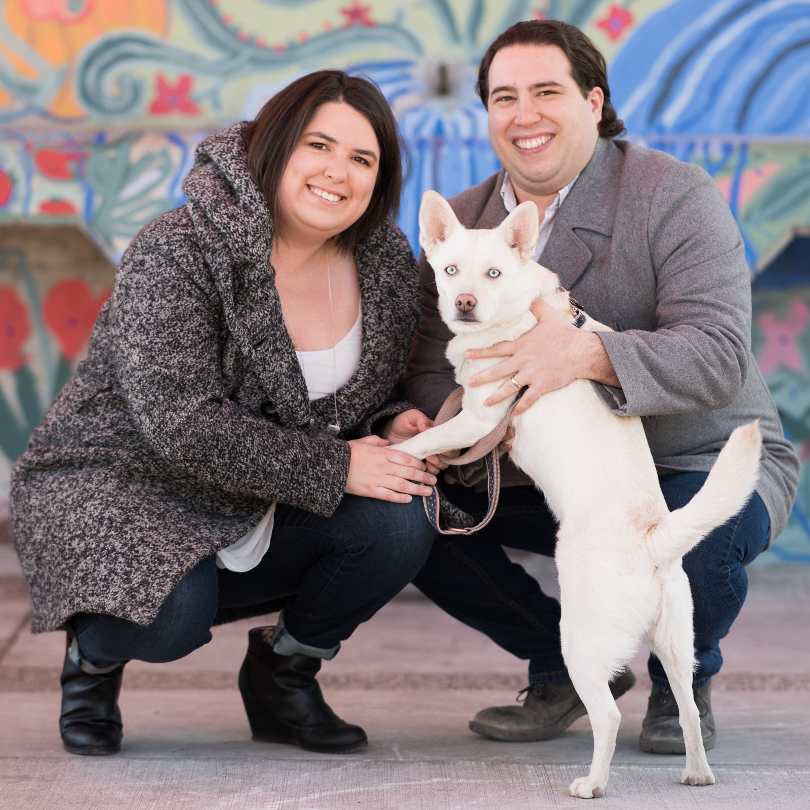 Suze, her husband Trevor, and their husky-mix Nova.