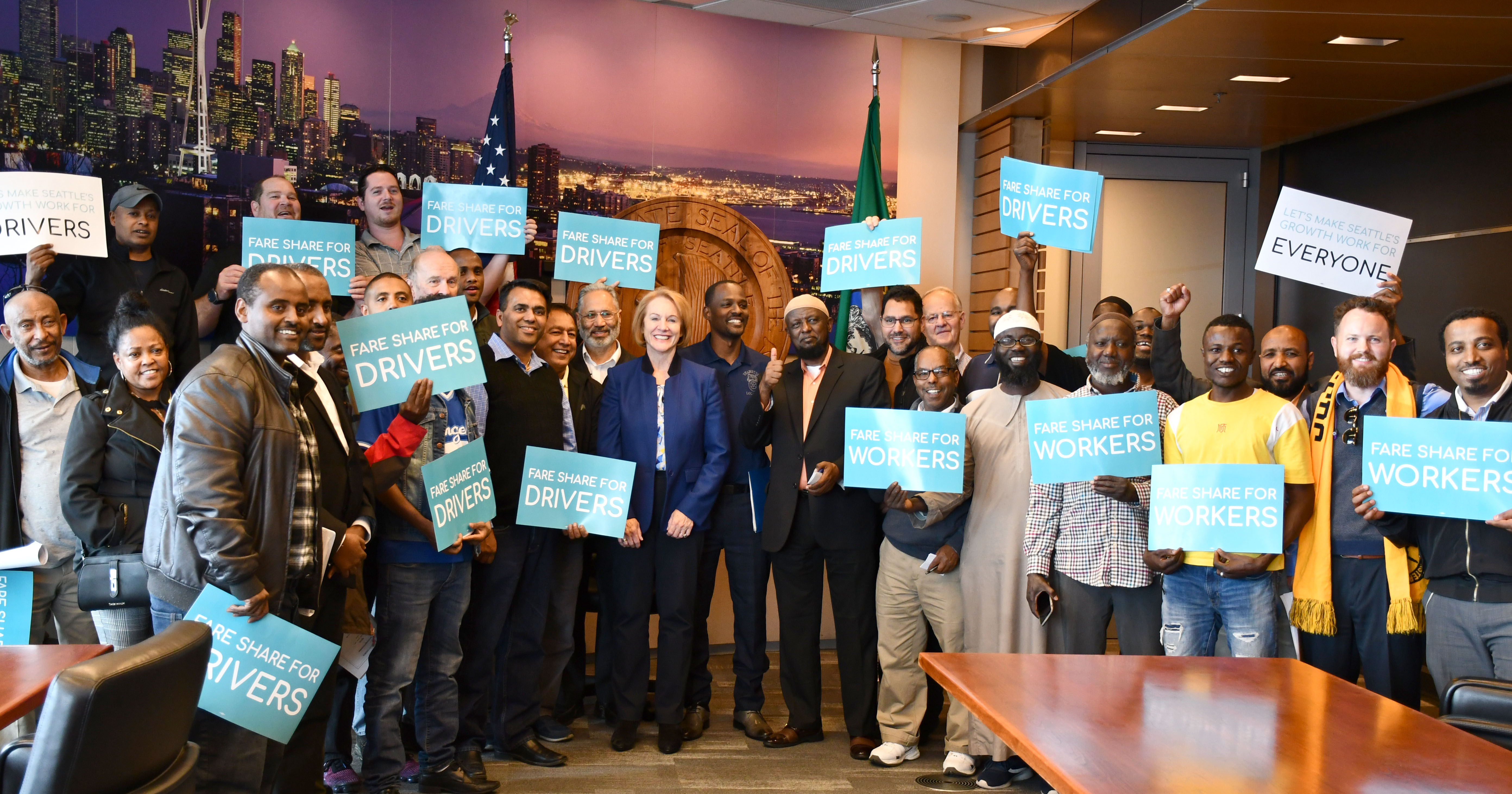 Seattle Uber & Lyft Drivers Call Passage of 'Fare Share' Legislation a Historic Victory Image