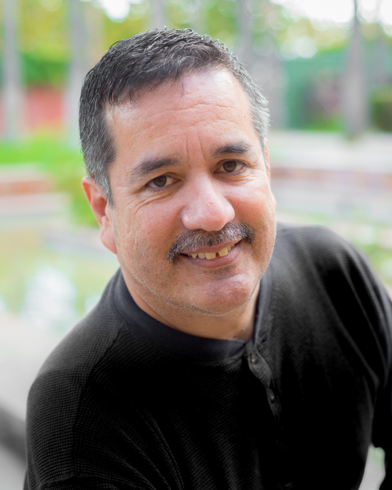 Headshot of Russell Rodríguez
