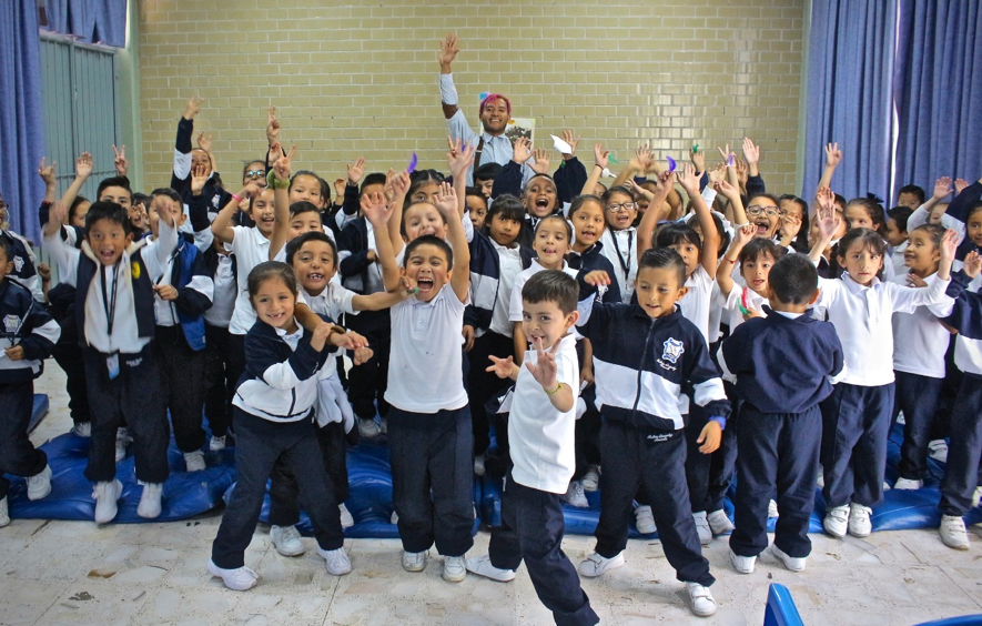 A group of children smiling and cheering
