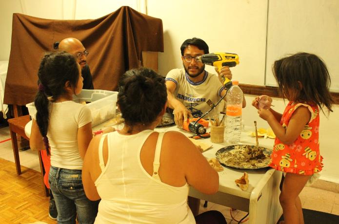 Members of La Quinta Teatro work with young children on hands-on arts activities