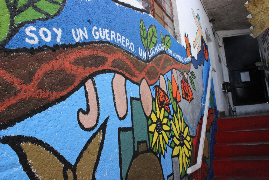 A colorful mural next to a staircase