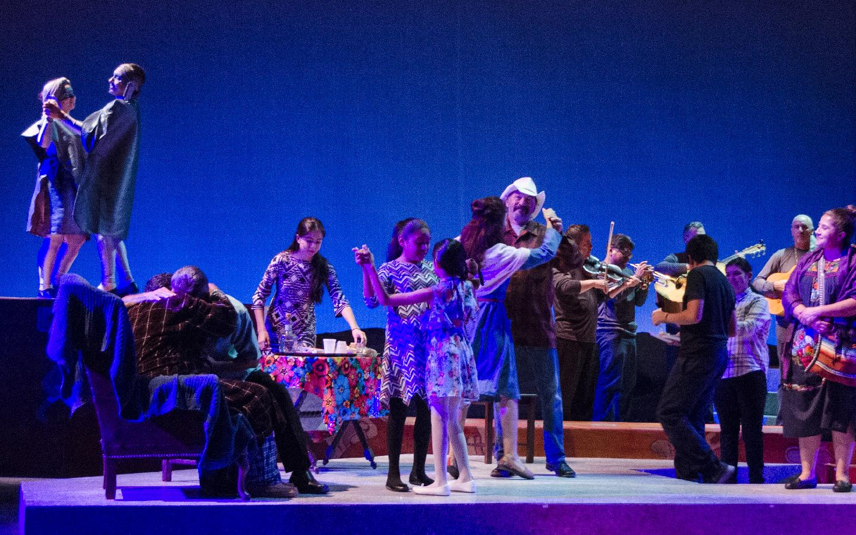A group of actors dance in Departera