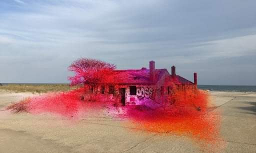 A house in front of a flat horizon with bright splashes of orange, red, and purple