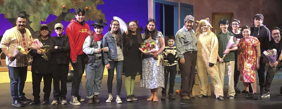 A line of youth performers and adult directors and crew on stage after a performance of The Transition of Doodle Pequeño