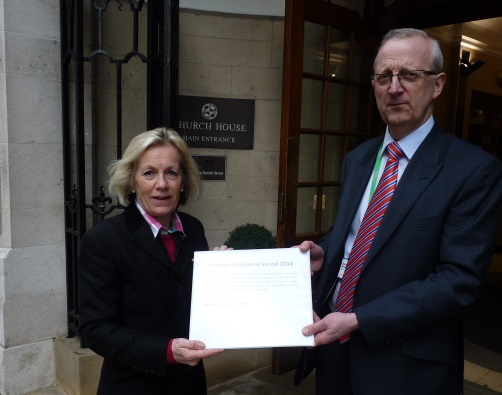 Tessa hands the petition to Andrew Brown