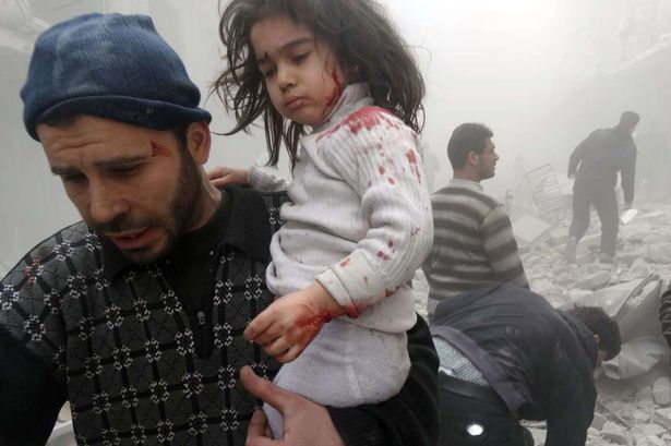 A-Syrian-man-evacuates.jpg