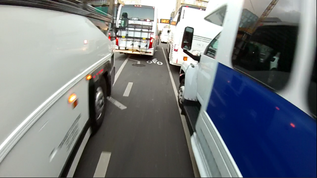Tech buses in the bike lane