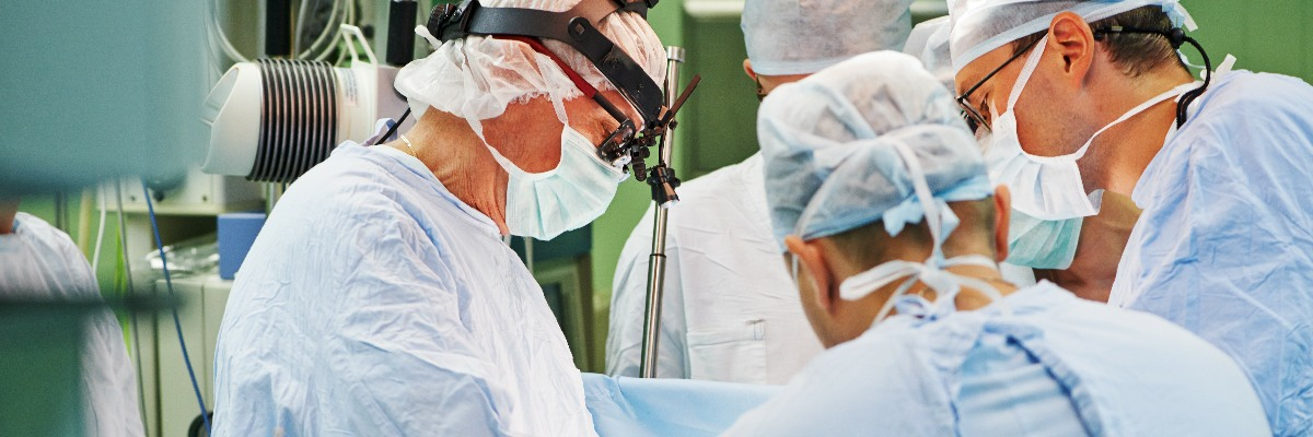 Surgeons operating in theatre.