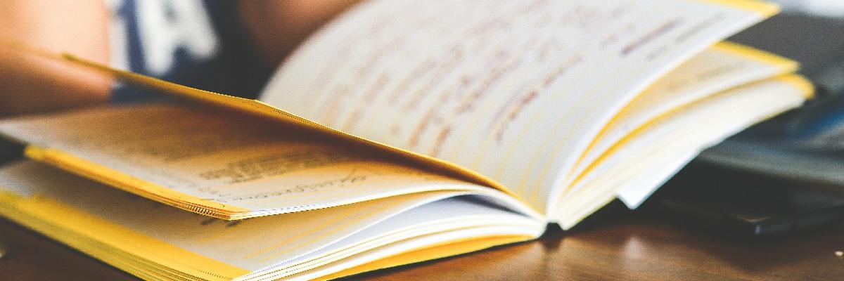 A notebook open on a desk.