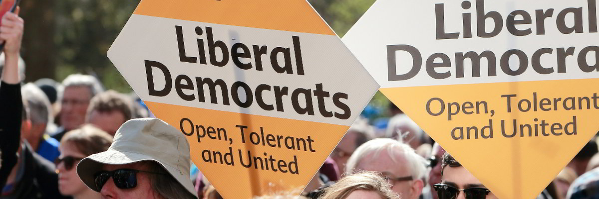 Diamond posters with text 'Liberal Democrats: Open, Tolerant and United