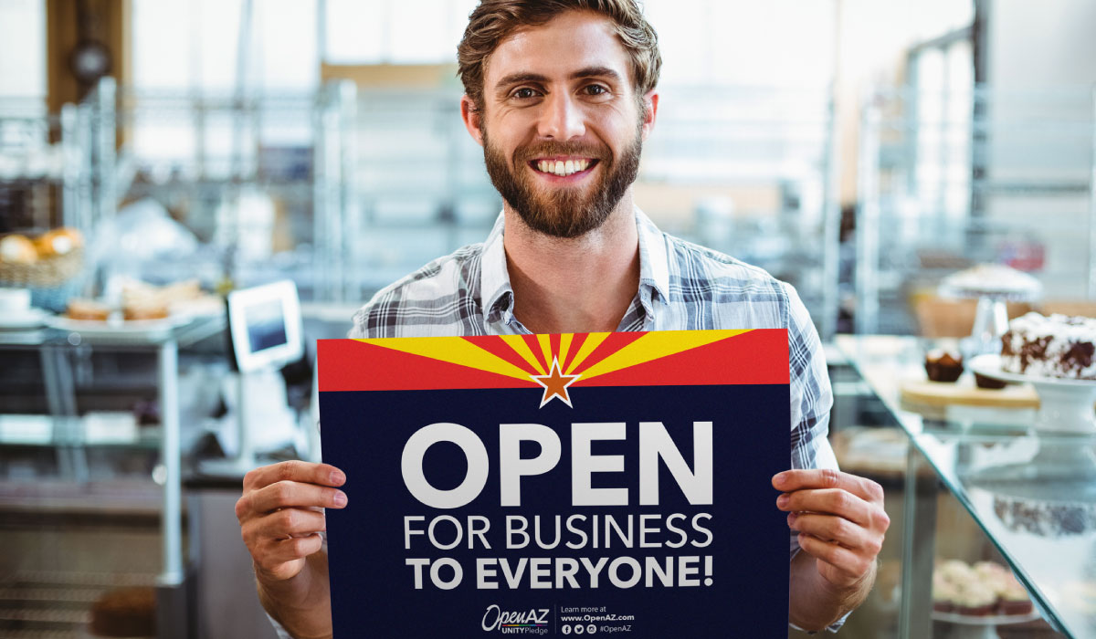 Businessman holding OpenAZ Official Sign Open for Business to Everyone