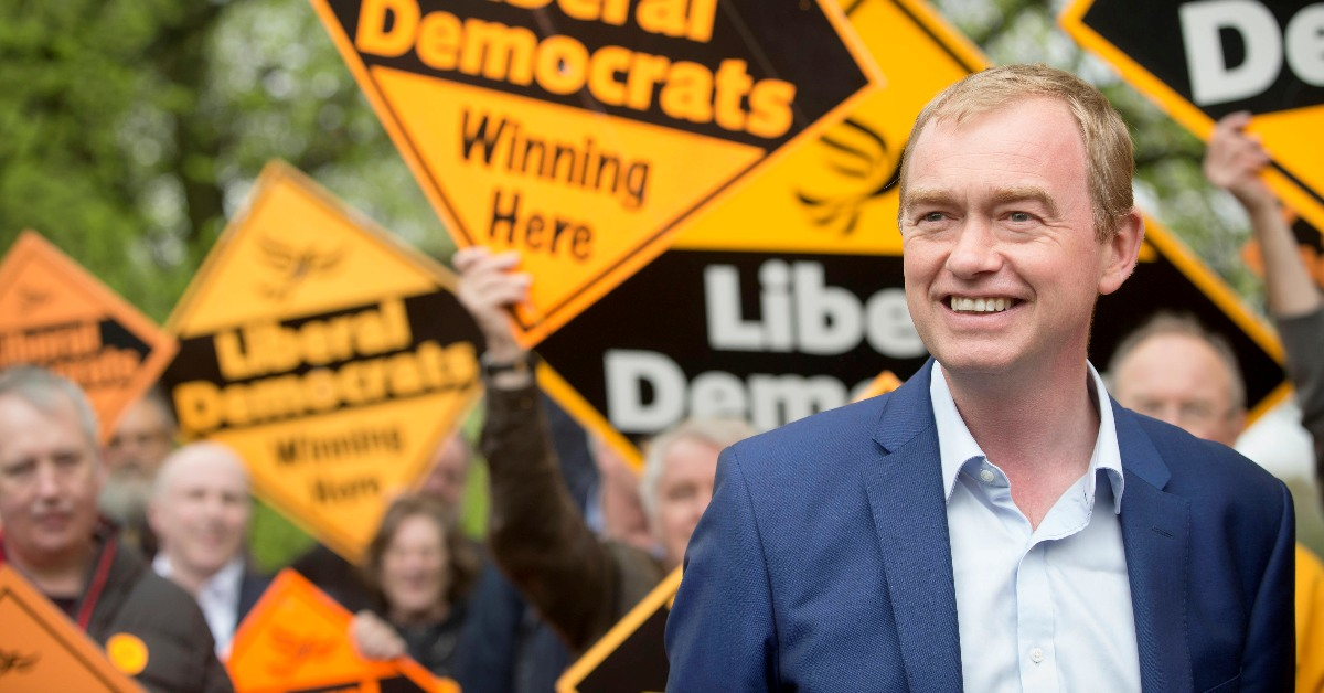 Tim Farron in front of activists holding Lib Dem diamonds. Links to: The government has done impact assessments on drains and comedy but not Brexit
