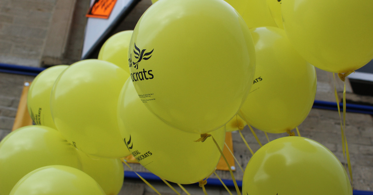 A cluster of Liberal Democrat balloons.