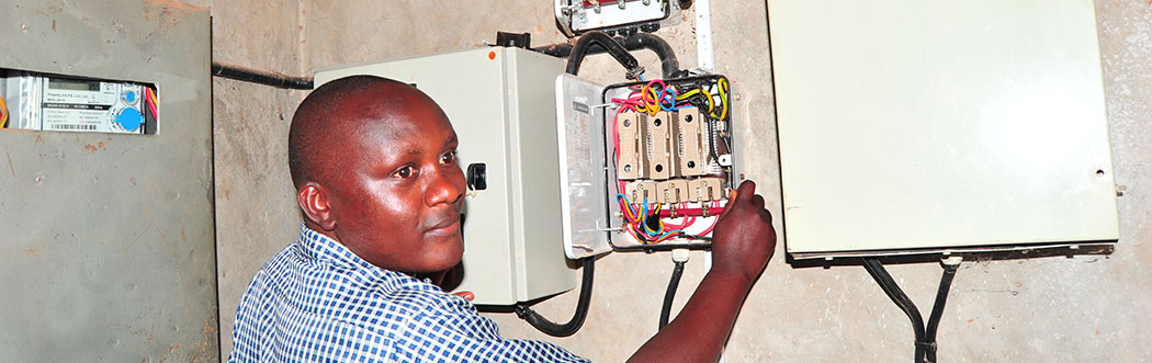 Photgraph of a man working on an electrical panel