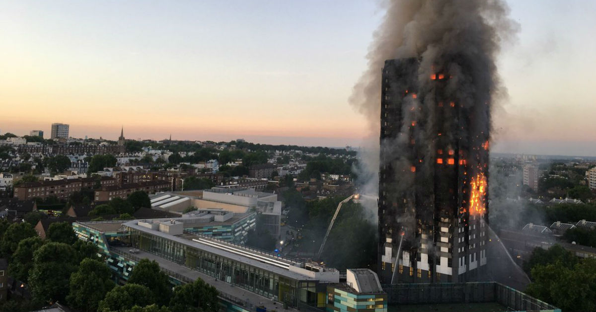 Grenfell Tower in flames. Links to: The Government is failing to meet post-Grenfell promises