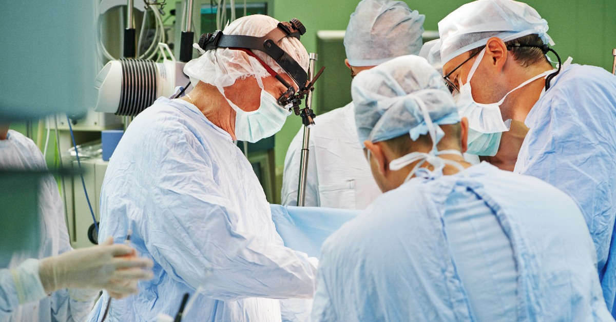 Surgeons operating in theatre. Links to: Stop Brexit to Save the NHS and Social Care