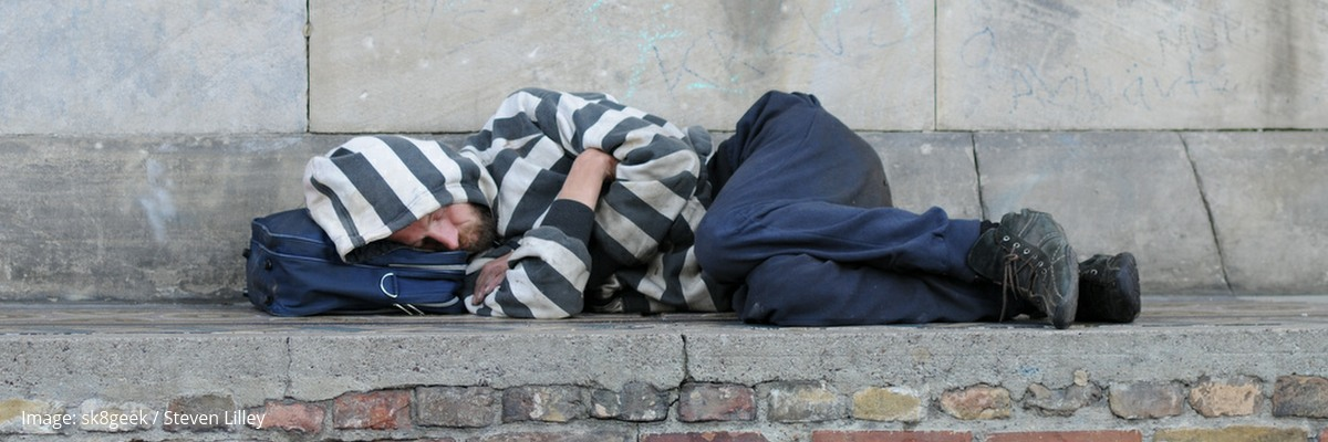 A man sleeping rough.