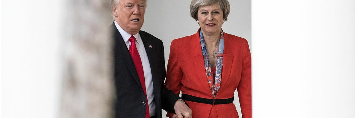 Donald Trump and Theresa May holding hands at the White House.