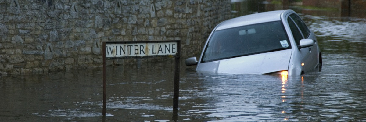 A car stranded in flood waters.
