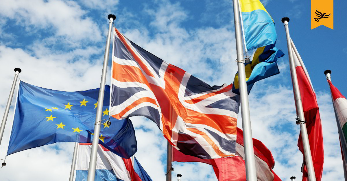 The union flag flying next to the EU flag.