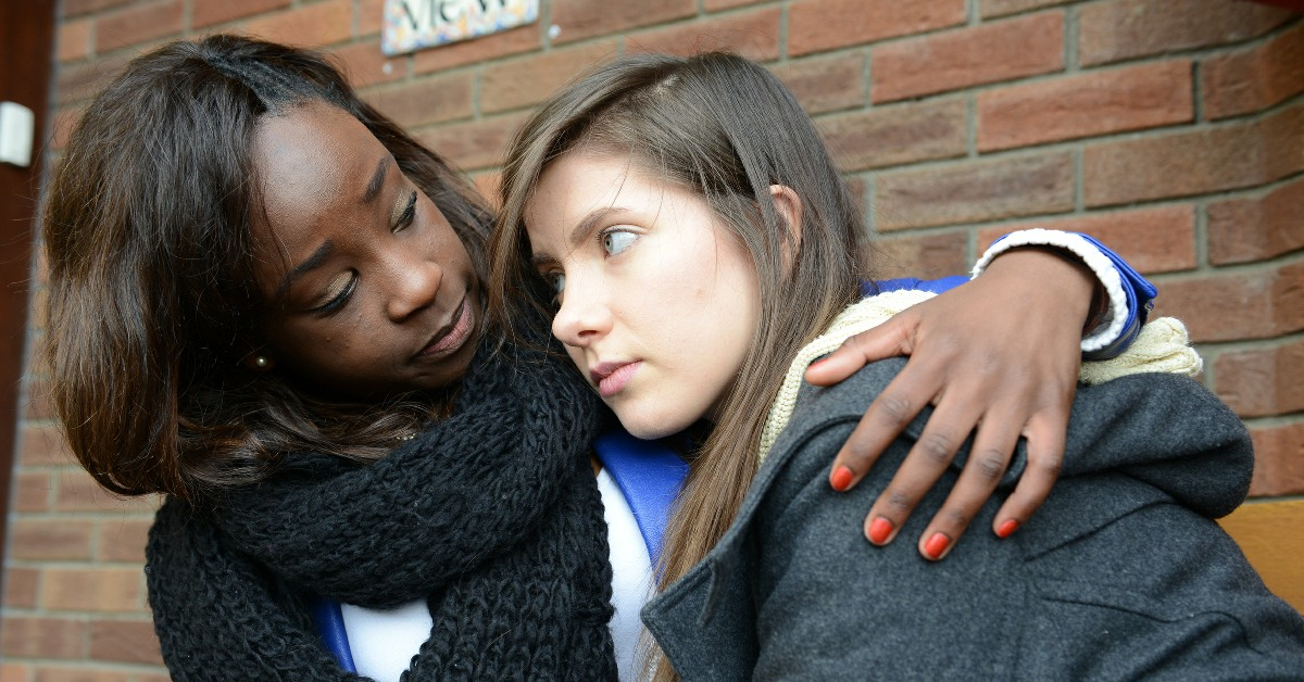 Woman comforting girl. Links to: We have a duty to support young people with their mental health