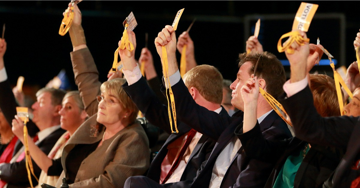 Lib Dem conference delegates voting. Links to: Plans for Autumn Conference on hold