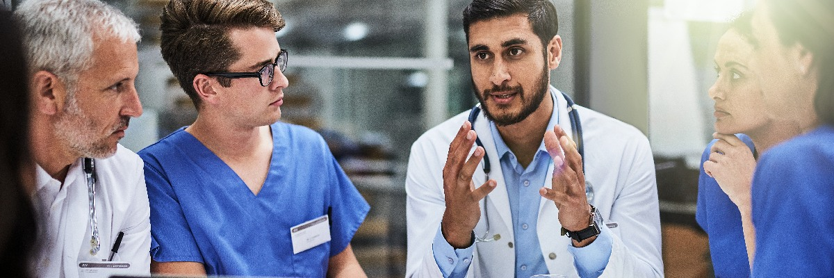 Six medics in discussion.