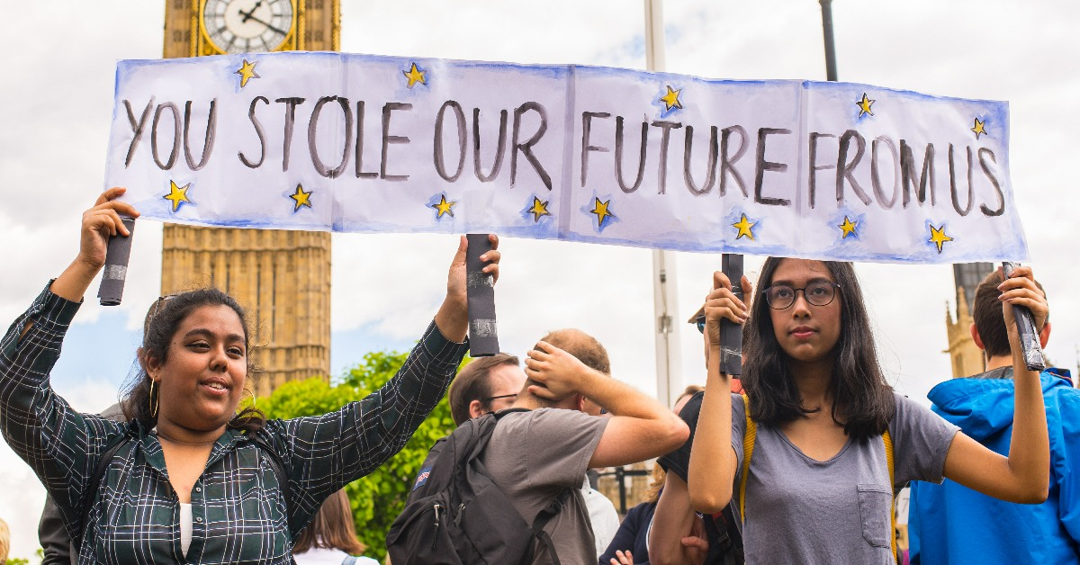 Young women holding a sign reading You Stole Our Future From Us at an ant-Brexit march