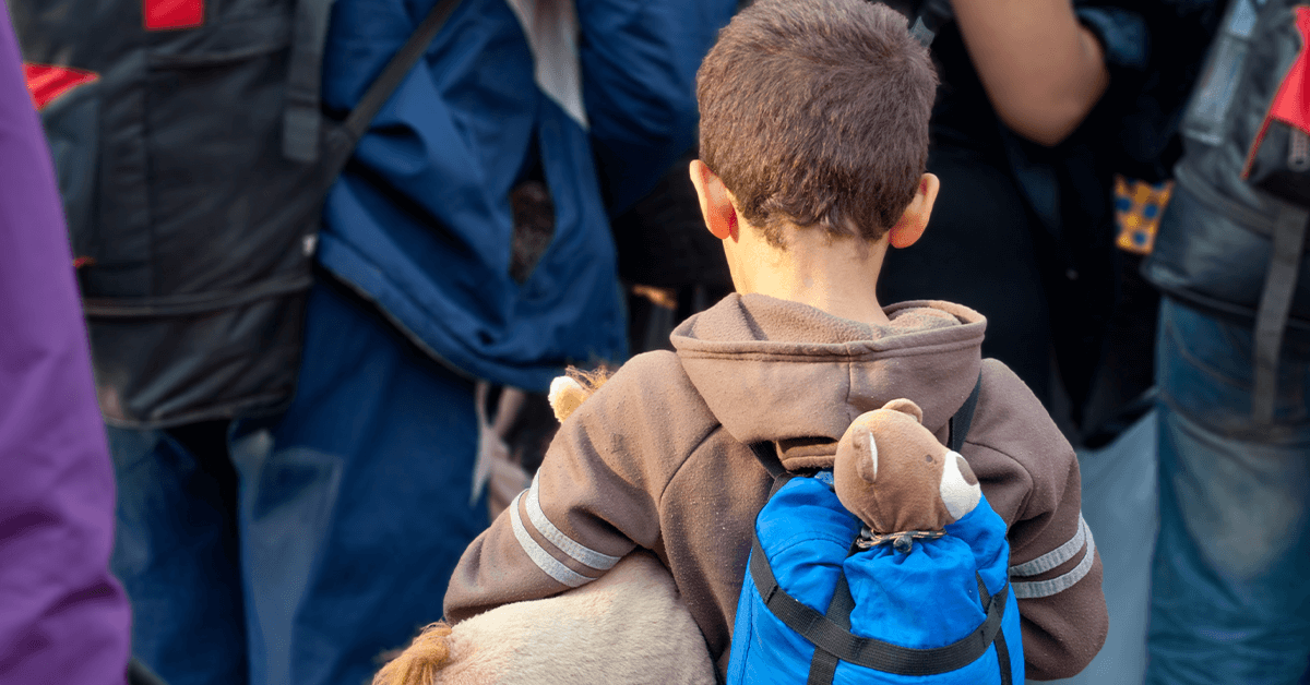 A child refugee with teddy bear in backpack Links to: We must show compassion to our Afghan heroes and their families