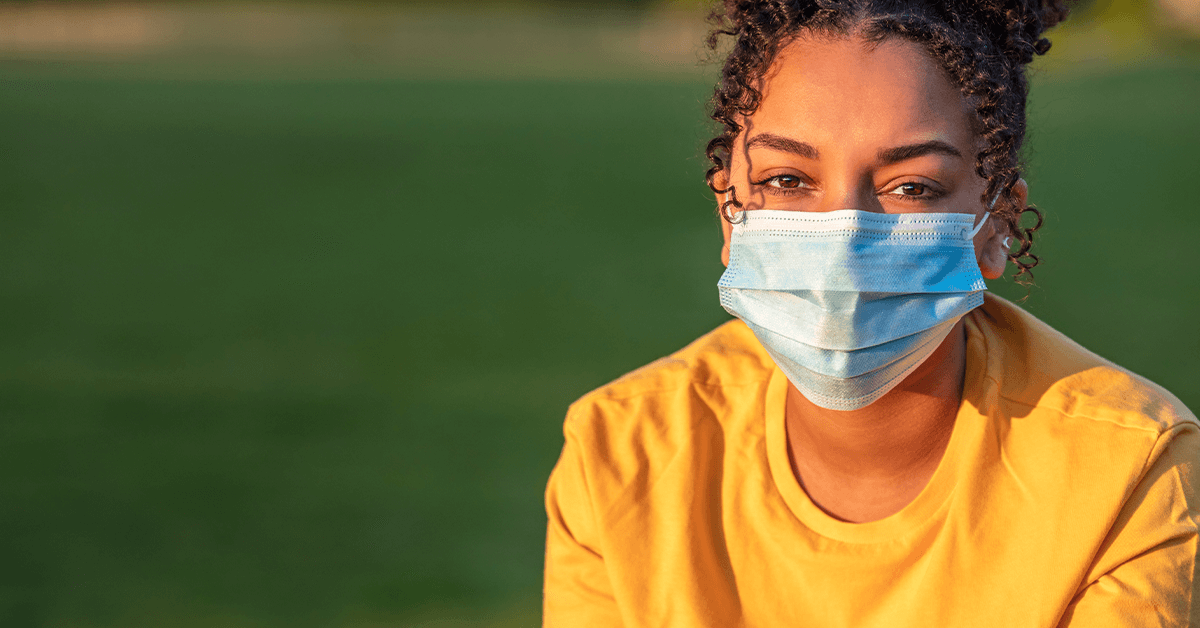 Person wearing a medical mask outdoors