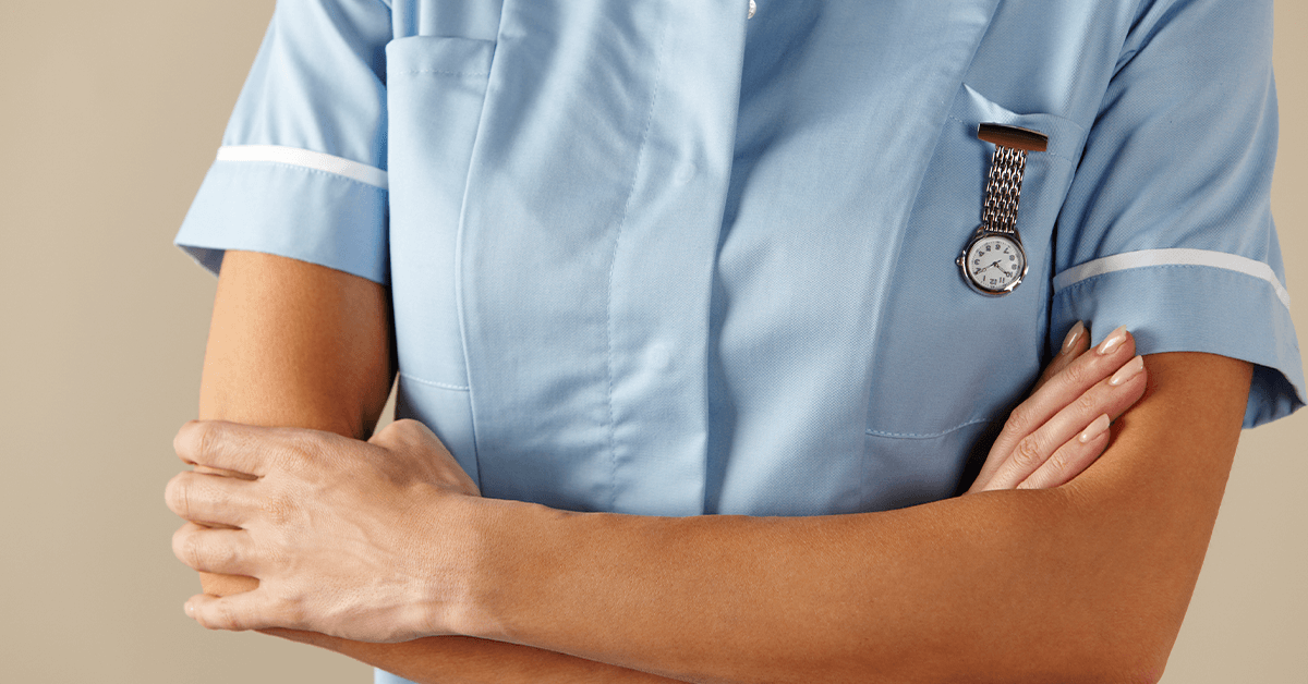 Upper body of nurse with arms crossed