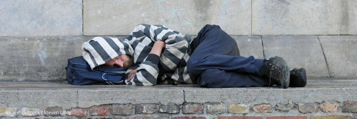 A man sleeping rough.