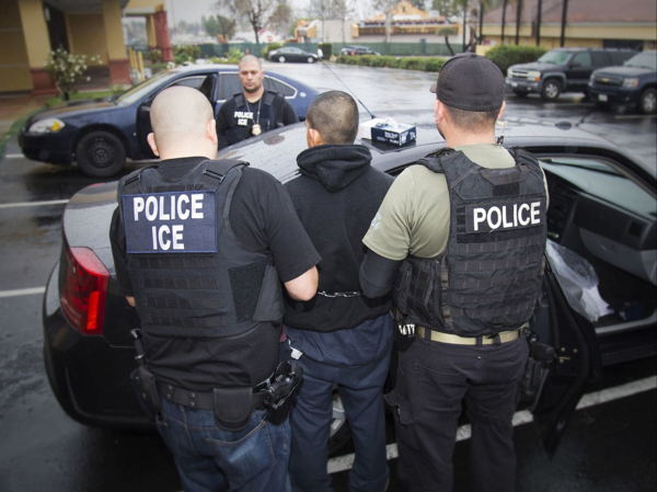 Federal_agents_arrest_a_foreign_national_during_an_immigration_enforcement_raid_in_Los_Angeles_on_Feb._13._(Charles_Reed-U.S._Immigration_and_Customs_Enforcement)_a.jpg