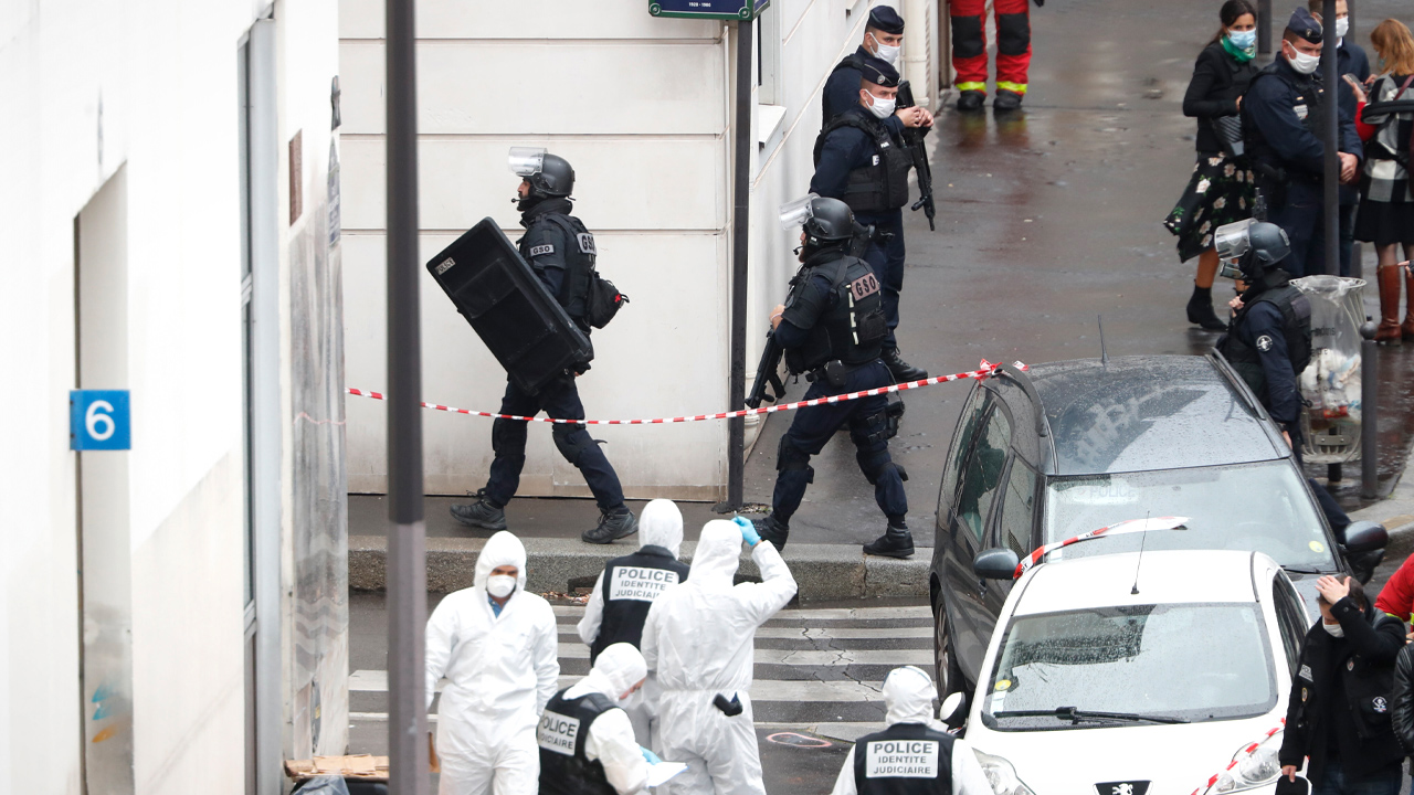 "Two people seriously injured near former Charlie Hebdo office in Paris, witness reports man with ""machete or knife"""