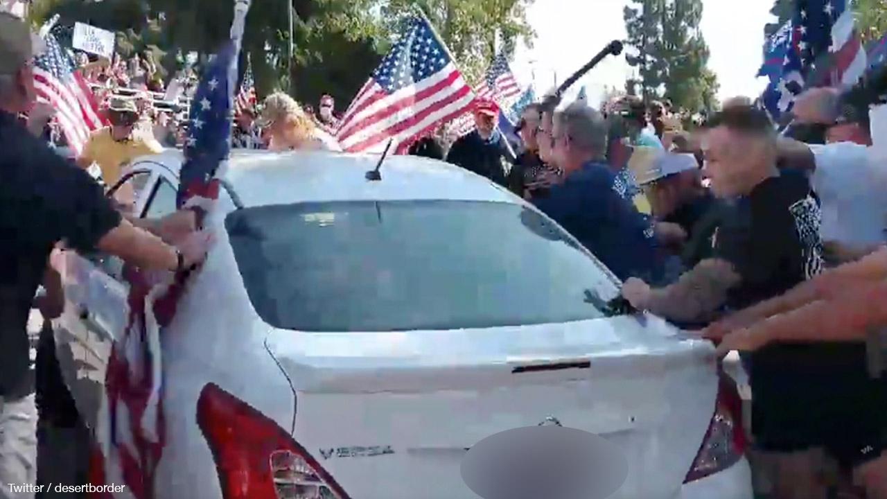 BLM organiser plows car through crowd of Trump supporters