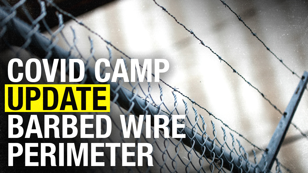 Story changes on why COVID camp is lined with barbed wire
