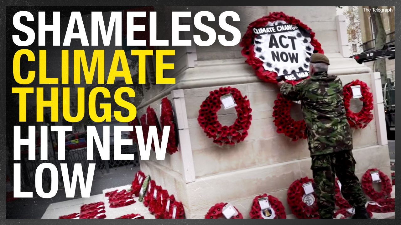 "Eco-vandals bring ""climate change means war"" banner to Britain's national war memorial"
