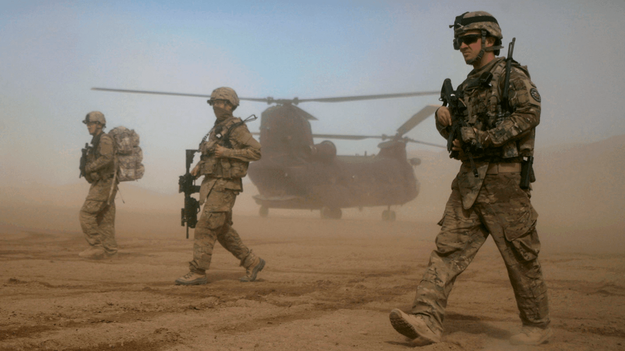 NATO troops may stay in Afghanistan past May deadline, in reversal of Trump policy