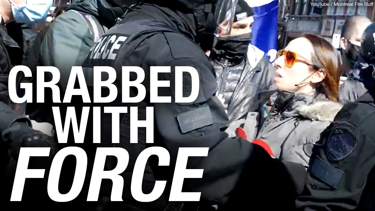 Montreal police grab masked woman at protest, issue $3k in COVID fines