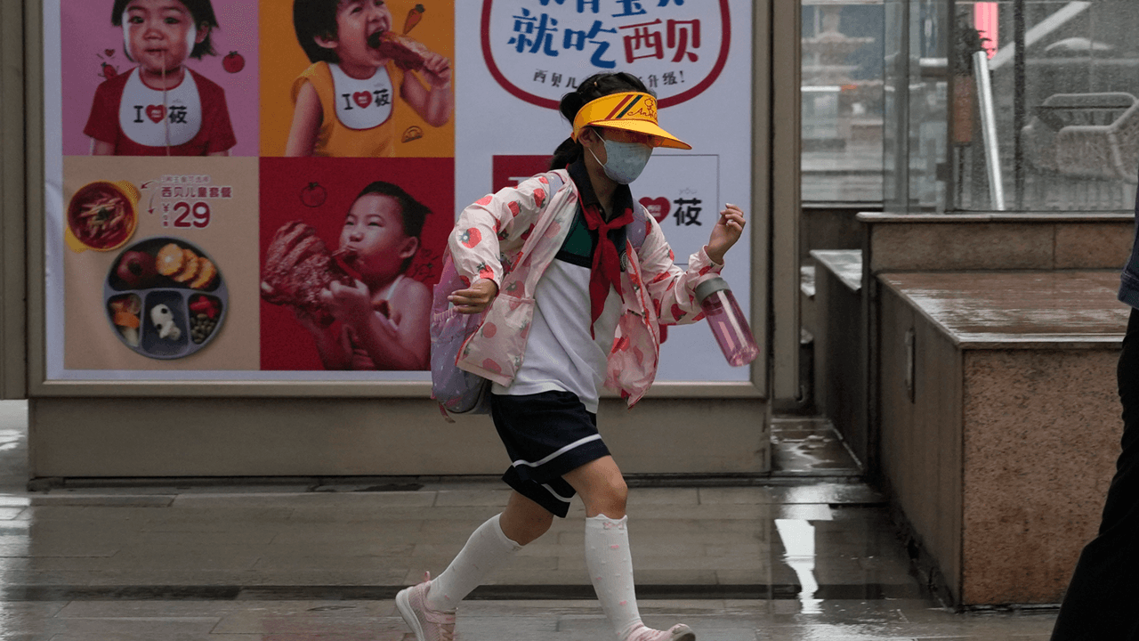 China allows families to have three children amid steep decline in birth rate